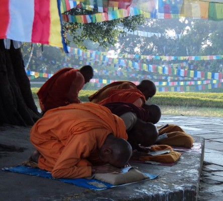 Monks praying in the sacred garden of Lumbini the birthplace of Buddha
